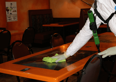 disinfecting restaurant table